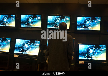 Customers browse in the television department at Circuit City electronics store - Stock Photo