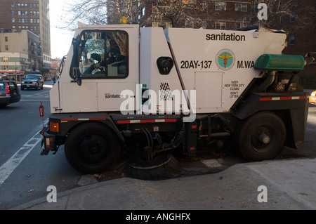 A Dept Of Sanitation Street Sweeper Cleans Up After A Parade Stock - Nyc street sweeping map