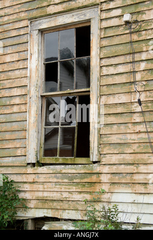 Broken window in the lower 9th Ward New Orleans Louisiana - Stock Photo