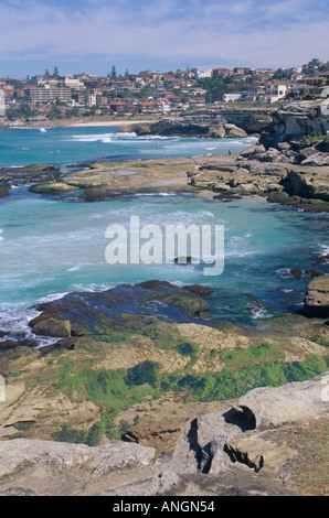 Bondi to Coogee famous costal walk, view of coves with town of Bronte in distance. Sydney NSW, Australia. - Stock Photo