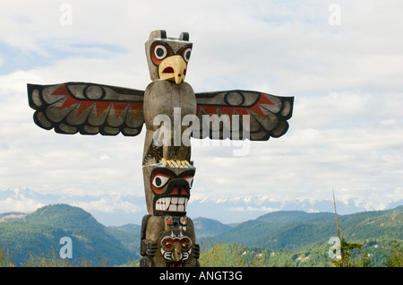 A totem pole along the Malahat Drive near Victoria, Vancouver Island, British Columbia, Canada. - Stock Photo