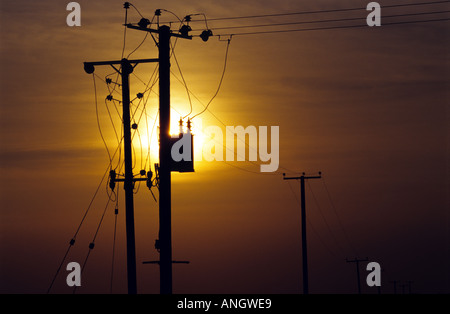 Electricity wires supplying power to the remote village of Bawdsey in East Suffolk UK - Stock Photo
