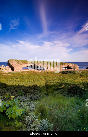 Natural rock archway created by tidal action in The Arches Provincial Park on the island of Newfoundland, Newfoundland - Stock Photo