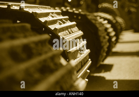 Close up of heavy equipment treads in sepia - Stock Photo