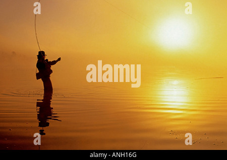 Fly-fishing at dawn on 108 Mile Lake, British Columbia, Canada. - Stock Photo