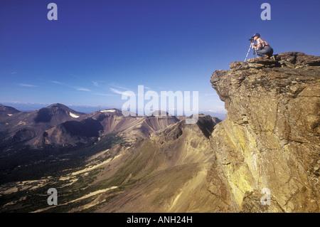 Hiker taking a photograph in Illgatchuz Park, British Columbia, Canada. - Stock Photo