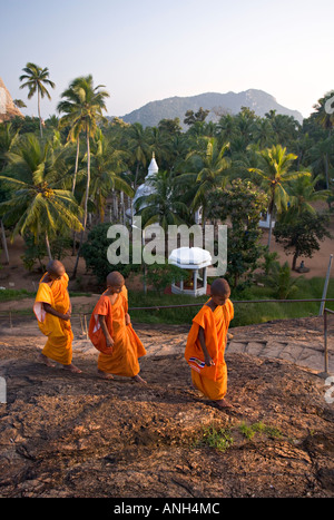 Novice monks in front of the Ambasthale Dagoba, Mihintale, Sri Lanka - Stock Photo