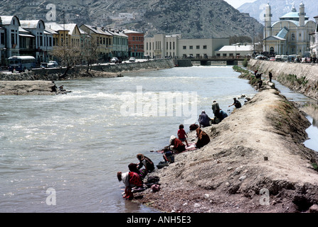 Kabul City River in full flow with people doing their daily ablutions Afghanistan Asia - Stock Photo