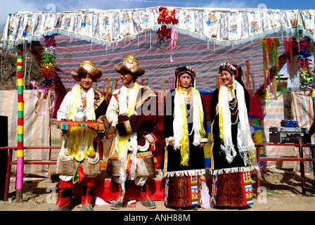 Tibetan wedding party,bride and groom,groomsman and a matron of homour. - Stock Photo