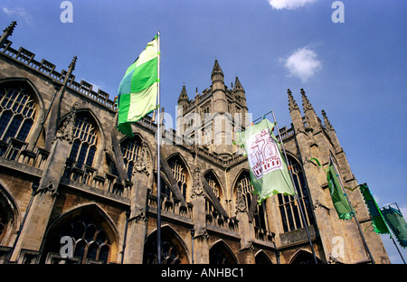 Bath Abbey decorated with brightly coloured flags during the Bath Festival - Stock Photo