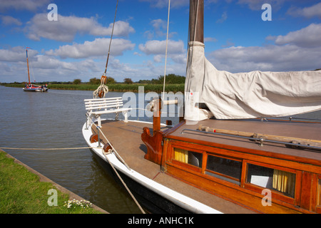 The trading Wherry Albion passes the pleasure Wherry Hathor at the Hermitage staithe near Acle in the Norfolk Broads - Stock Photo