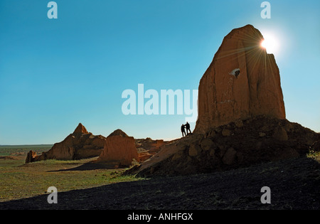 Tourists near the erosion formations of brown sedimentary minerals. Bayan Zag, South Gobi desert, Mongolia - Stock Photo
