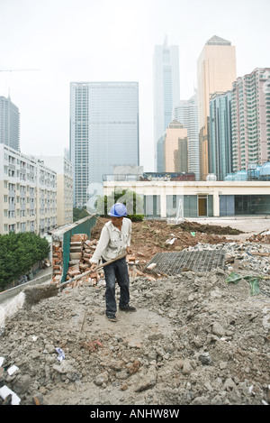 Worker in construction site - Stock Photo