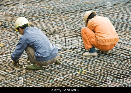 Construction workers working at construction site - Stock Photo