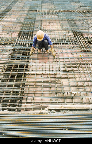 Construction worker working at construction site - Stock Photo