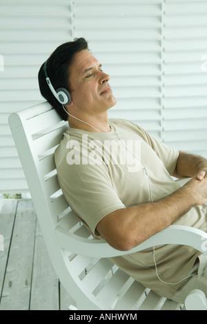 Mature Man Sitting In Rocking Chair Stock Photo 73981072