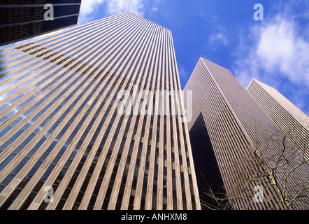 New York City Midtown Manhattan Modern Architecture Office Buildings Sixth Avenue Skyline Skyscrapers from low perspective. - Stock Photo
