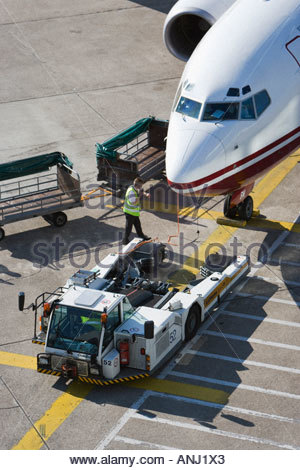 airliner jet airport air transport travel tractor truck baggage cart ground crew service Air Berlin Duesseldorf - Stock Photo