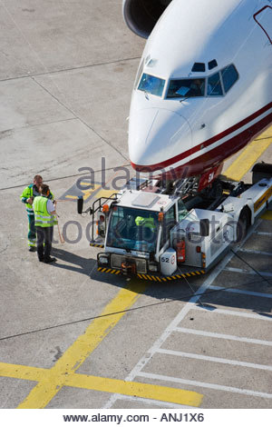 airliner jet airport air transport travel tractor truck ground crew service check ready Air Berlin Duesseldorf Germany - Stock Photo