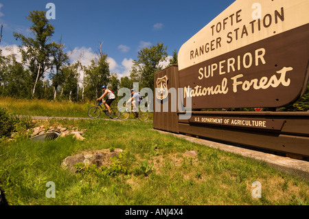 TWO CYCLISTS RIDE THE GITCHI GAMI BICYCLE TRAIL SUPERIOR NATIONAL FOREST - Stock Photo