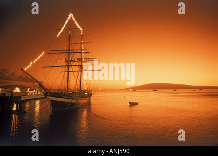 Schooner anchored in Lahaina on Island of Maui at sunset - Stock Photo