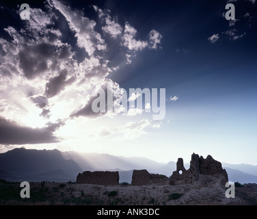 Sun-rays And A Destroyed House On The Salang Road, Kabul, Afghanistan - Stock Photo