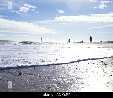 Low view of shoreline Caister beach on a bright winter s morning - Stock Photo