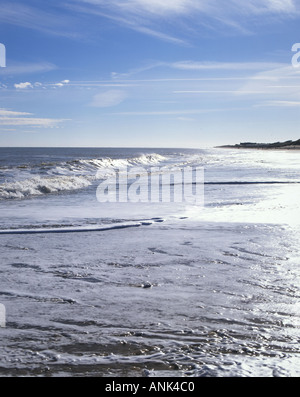 Shoreline view of Caister beach on a bright winter s morning - Stock Photo