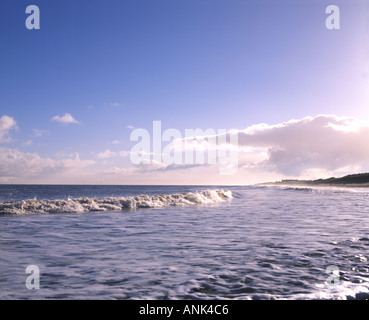 Shoreline view of Caister beach on a bright winter s morn - Stock Photo