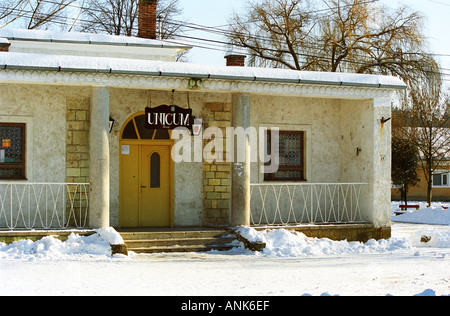 """In the Tokaj village Mad: a bar / café with a sign advertising """"Unicum"""" the very typical Hungarian alcohol. Mad is one of the main villages in the Tokaj district."""