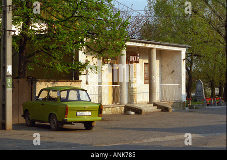"""In the Tokaj village Mad: a bar / café with a sign advertising """"Unicum"""" the very typical Hungarian alcohol and a classic Trabant car."""