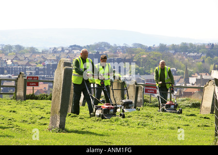 Mowing the grass in the cemetery at St Mary s church East Cliff Whitby Yorkshire England - Stock Photo