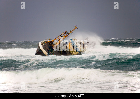 Beached grounded wreck of Banff Fishing Vessel boat BF 380 aground on rocks at Cairnbulg Point Fraserburgh, North - Stock Photo