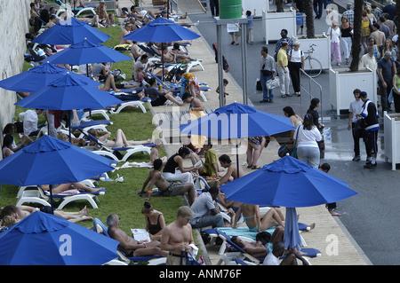 An artificial Beach set up along the Seine River in Paris, France. - Stock Photo
