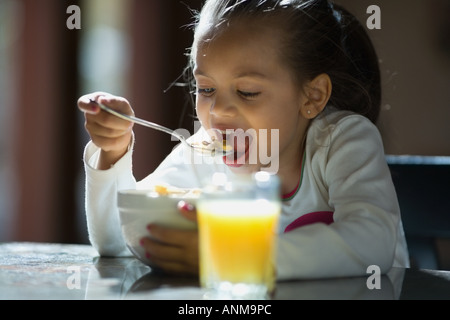 Close up of a girl eating cereal - Stock Photo