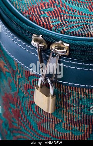 Travel case zipper locked with padloc - Stock Photo