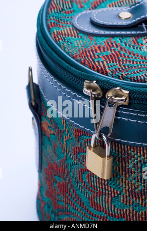 Travel case zipper locked with padlock - Stock Photo