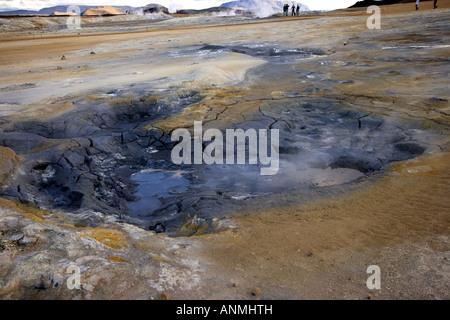 Mud pot in Namaskard Solfatara field of steaming solfataras sulphurous vents Myvatn lake Iceland - Stock Photo