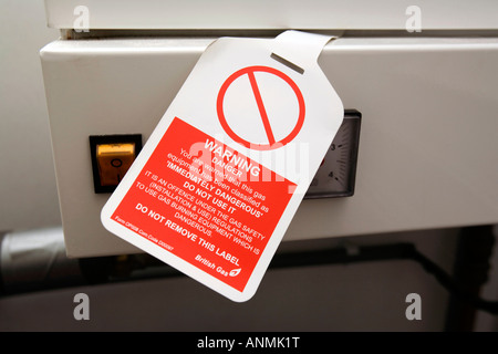 gas safety British Gas notice condemning condensing gas central heating boiler as unsafe - Stock Photo