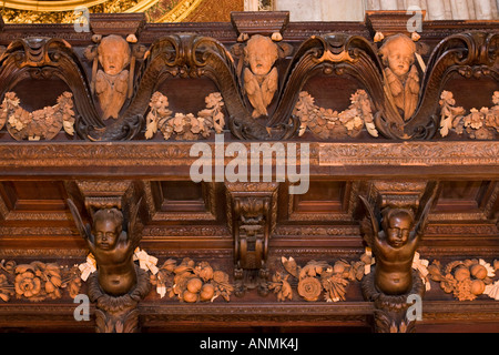 UK London Saint Pauls Cathedral choir Grinlings Gibbons carvings of Cherubs and swags above stalls - Stock Photo