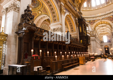UK London Saint Pauls Cathedral Bishops throne and choir stalls decorated by Grinling Gibbons woodcarvings - Stock Photo