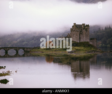 Eileen Donan Castle in morning mist at the head of Loch Duich on the road to Skye 17th century castle reconstructed - Stock Photo