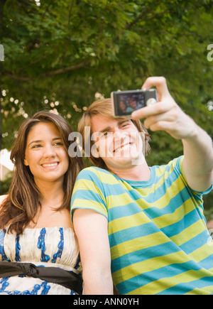 Couple taking own photograph - Stock Photo