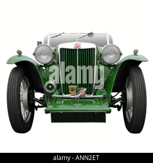 A Vintage MG sports car in British Racing Green isolated on white - Stock Photo