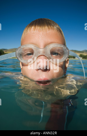 Boy wearing swimming goggles in water, Utah, United States - Stock Photo