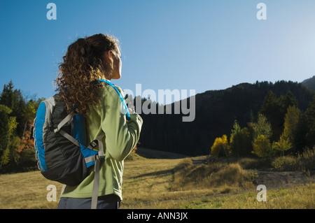 Woman wearing backpack outdoors, Utah, United States - Stock Photo