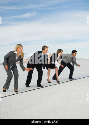 Businesspeople at starting line for race, Salt Flats, Utah, United States - Stock Photo