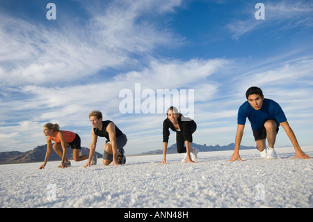 People at starting line on salt flats, Utah, United States - Stock Photo