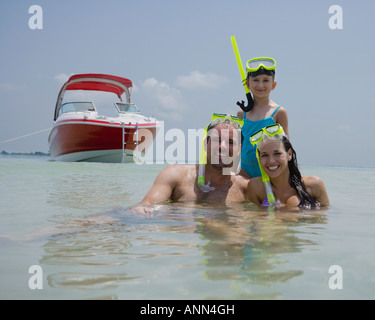 Family with snorkeling gear in water, Florida, United States - Stock Photo