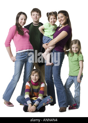 Portrait of a woman and her children smiling - Stock Photo